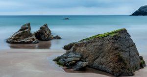 calm ocean with big rock